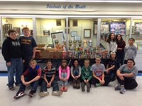 Heritage Food Drive Brings in 400 Items for Caring & Sharing