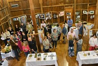 Overhead picture of attendees viewing artwork