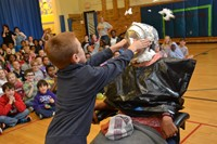 A Hanby student pushes a pie into the face of the principal during an building assembly.
