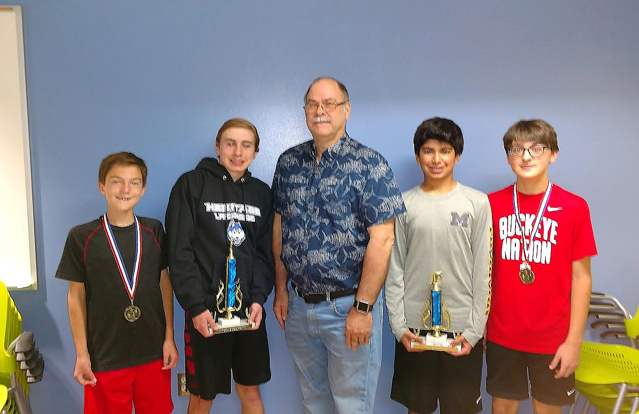 Marv McDaniel, is pictured with chess champions