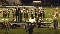 Westerville North's band performs on the football field during a band competition.