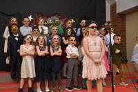 "First grade friends sing the ""Vowel Rap."""
