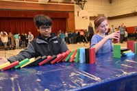Fifth graders uses blocks to transfer energy