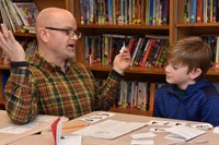 A father and son have fun with math games