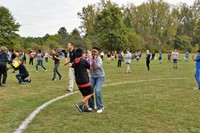 Student participate in balloon relay race