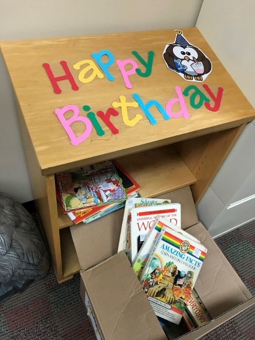 Birthday book shelf at Alcott Elementary