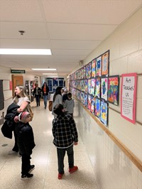 Cherrington families view student work hanging in the halls of the school.