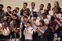 Fourth grade pupils, directed by Sarah McPeak, played a variety of international songs on their recorders, before a packed gymnasium of proud parents.