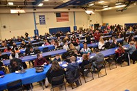 More than 200 families gathered in the gymnasium for the Pastries for PAWS celebration