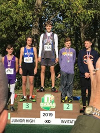Walnut Springs Runner Ben Gabelman on the podium at a recent competition.
