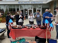 Alexandre Hedrick delivers donated instruments to Walnut Springs MS