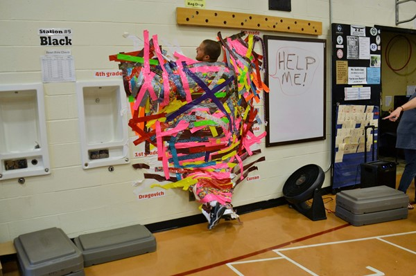 Robert Frost Physical Education teacher Eric Indiciani got duct taped to the wall.