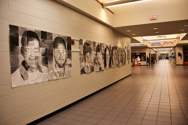 Student artists at Genoa created staff portraits which adorn the hallway.