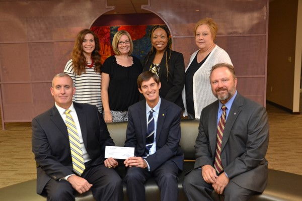 Knights of Columbus representatives presented Superintendent John Kellogg with a check for the Special Education department.